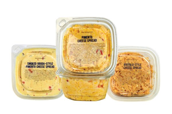 Packed deli containers with pimento cheese spread inside