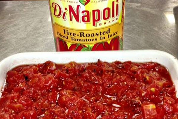 DiNapoli fire-roasted tomatoes poured into a tray