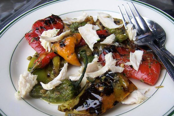 Plate of cheese and fire-roasted tomatoes and peppers