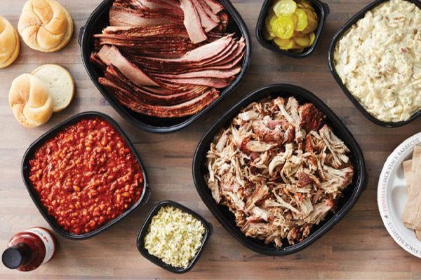 Assortment of barbecue food prepared for catering