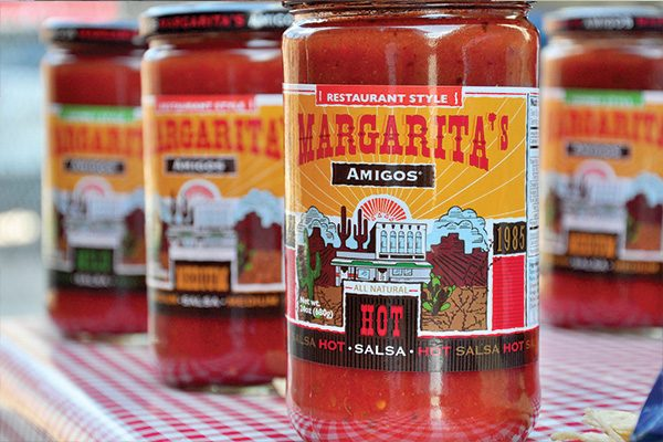 Several jars of Margarita's Amigos salsa with restaurant-style hot in the front