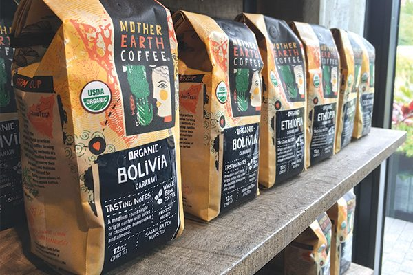 Line up of Mother Earth Coffee single origin retail bags on a shelf