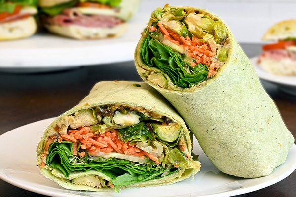 Close up of a veggie hummus wrap made by Parisi Kitchens